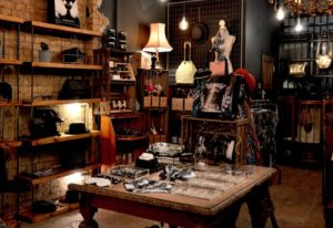 Interior of vintage shop with assortment of clothes and accessories